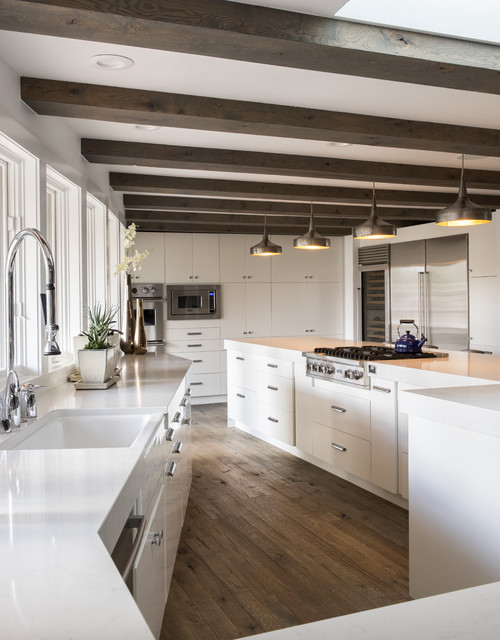 arteriors lighting Kitchen Contemporary with angled cabinets beamed ceiling