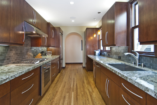 berenson hardware Kitchen Transitional with arch doorway dark wood