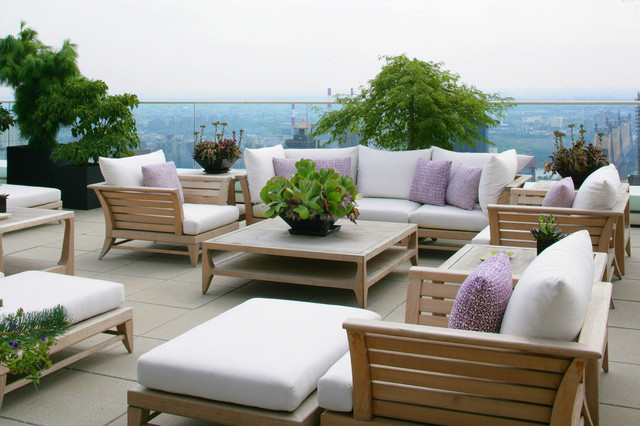 caracole furniture Deck Contemporary with container plants decorative pillows