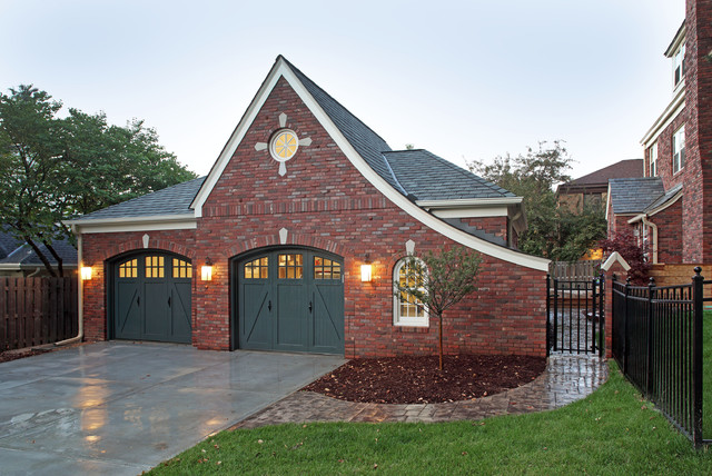 Carriage House Garage Doors Garage and Shed Traditional with Brick Concrete Driveway Exterior