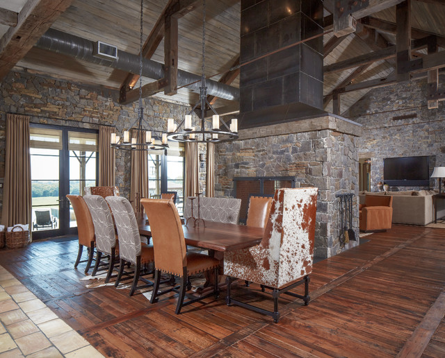 Cow Hides Dining Room Rustic with Ceiling Trusses Chandeliers Cow