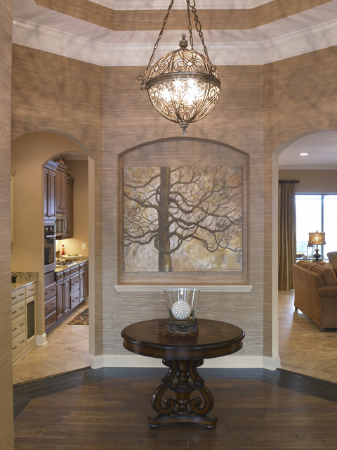 foyer chandeliers Entry Traditional with alcove arched doorways artwork