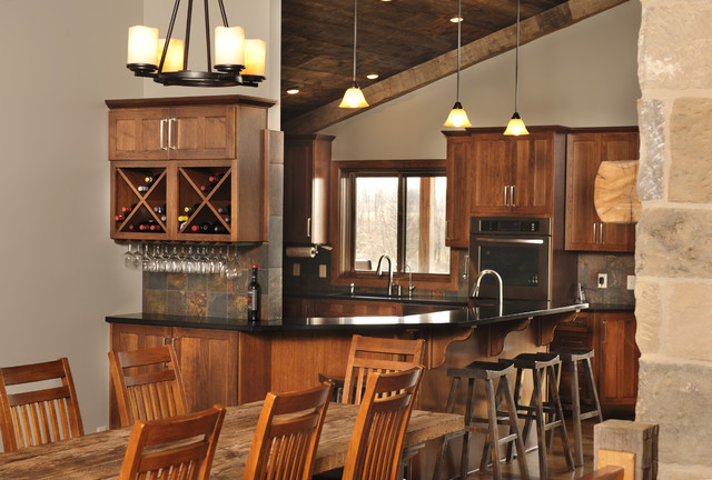 Hickory Cabinets Kitchen Rustic with Barstool Black Countertop Chandelier