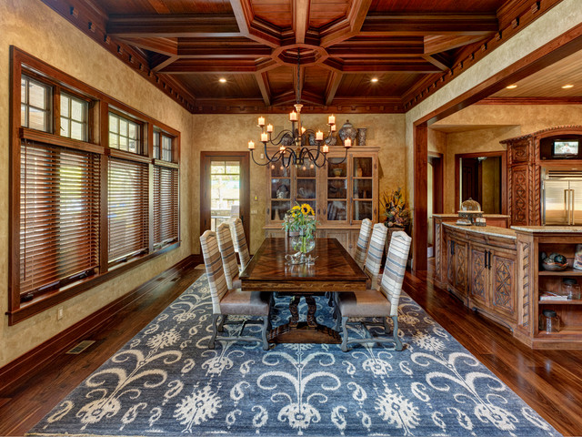 Ikat Rug Dining Room Traditional with Bar Baseboard Carved Chandelier