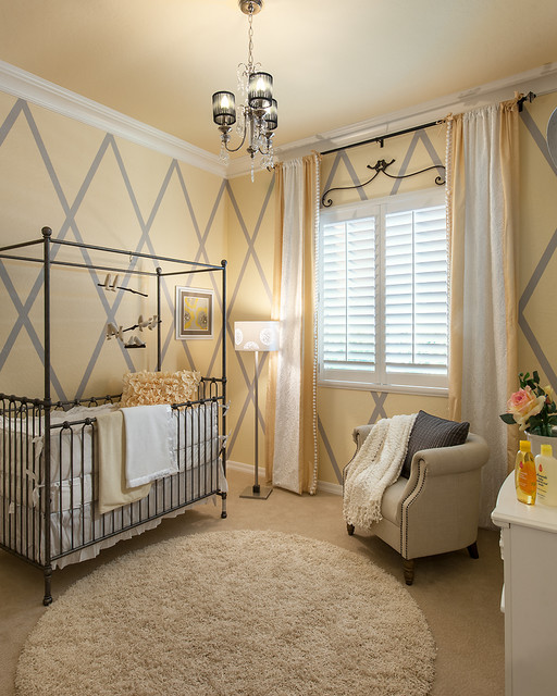 maracay homes Nursery Transitional with baseboard bird mobile chandelier