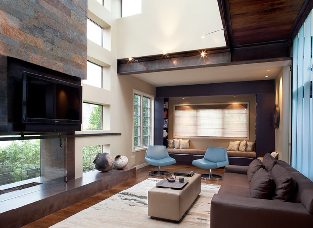 Mounting Tv Above Fireplace Living Room Contemporary with Beige Ottoman Blue Chairs