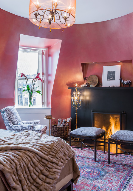 persimmon color Bedroom Eclectic with black fireplace chandelier curved