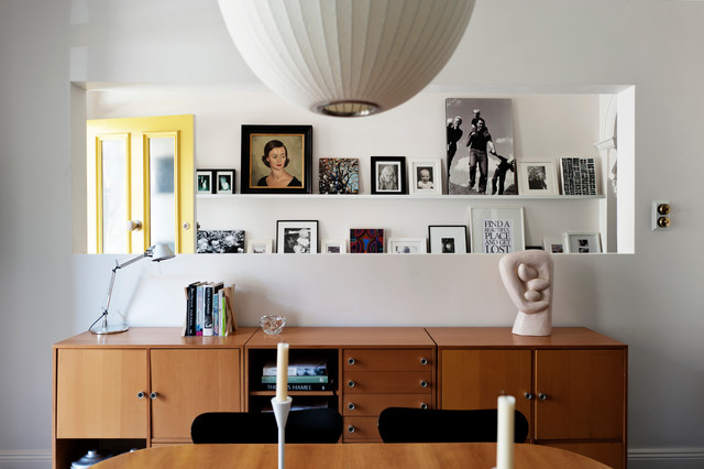 picture ledge shelf Dining Room Midcentury with black chairs book shelf