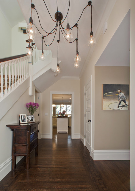pottery barn chandelier Entry Contemporary with banister baseboards chandelier console