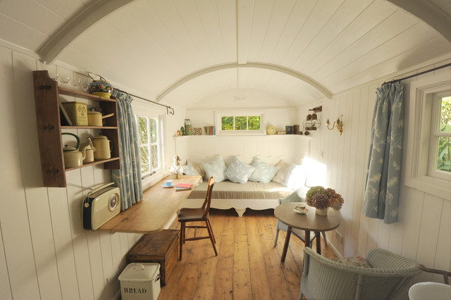 quonset hut homes Living Room Shabby-chic with antique floors antique tables