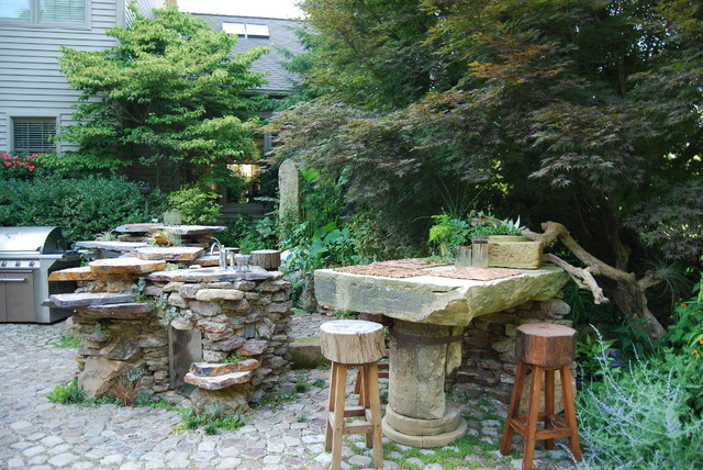 repurposed materials Landscape Eclectic with antiquereclaimedstonegrinding wheelb outdoor grill