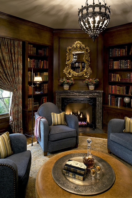 Round Leather Ottoman Family Room Victorian with Blue Armchairs Bookcase Bookshelves