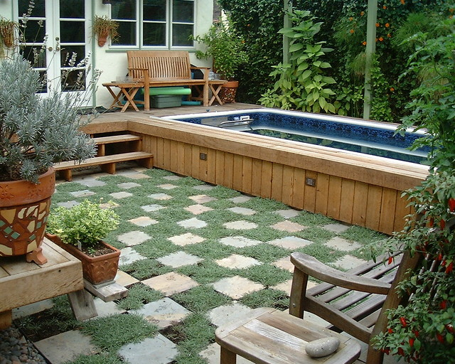 semi inground pools Landscape Contemporary with backyard checker pattern container