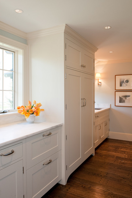 shaker cabinet doors Kitchen Transitional with baseboards blue ceiling lighting