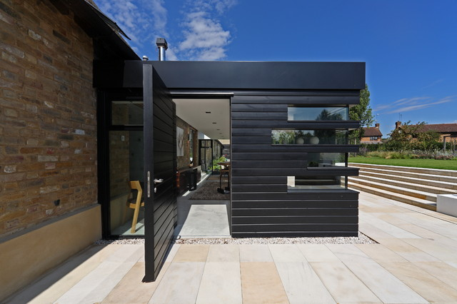Soss Hinges Entry Contemporary with Barn Black Siding Extension