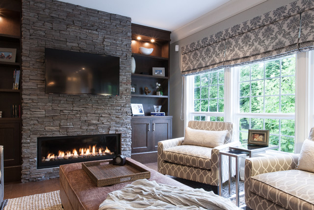 Stacked Stone Fireplace Family Room Traditional with Brown Ottoman Built in Bookcase