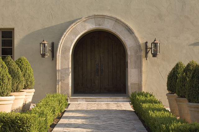 stucco finishes Entry Traditional with antique doors arched doorway