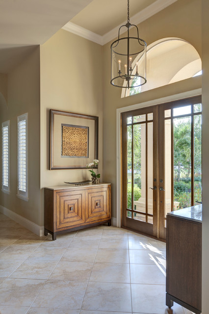 Tommy Bahama Furniture Entry Transitional with Arched Window Beige Walls