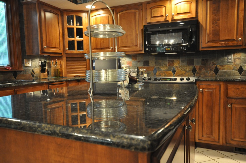 uba tuba granite Kitchen Eclectic with granite countertop tile backsplash