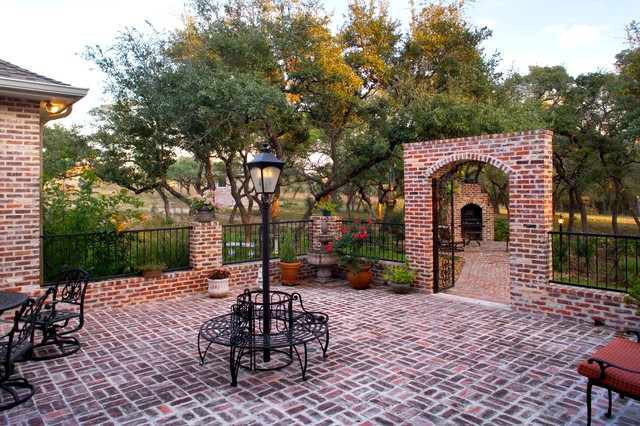 Wrought Iron Fencing Landscape Traditional with Brick Arches Courtyard Lamp