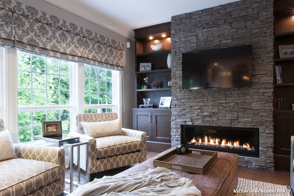 Stackable stone fireplace with built ins on each side for for Fireplace with windows on each side