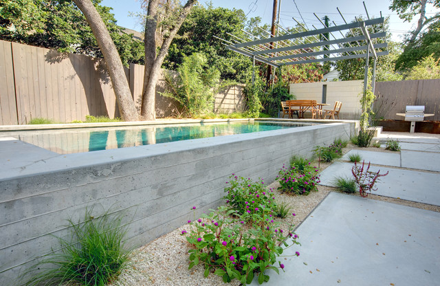 Above Ground Pools with Decks Landscape Modern with Backyard Concrete Wall Grasses