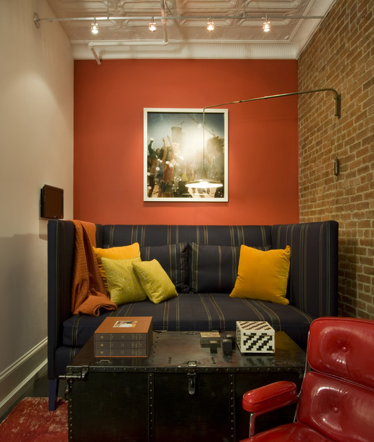Alphera Financial Services Family Room Industrial with Accent Wall Brick Wall
