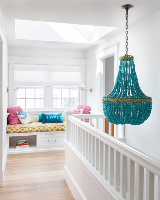 beaded chandelier Hall Beach with bright pink throw pillows