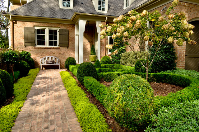 Boxwood Shrubs Landscape Traditional with Arched Garage Door Brick