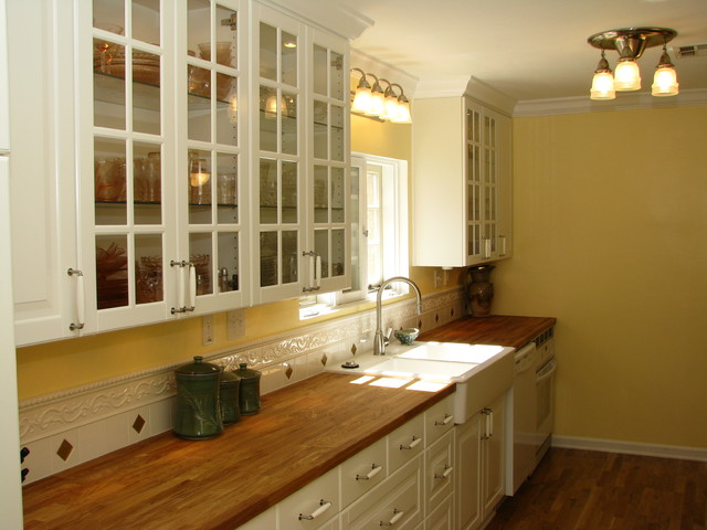 butcher block countertop Kitchen with antique stove butcher block