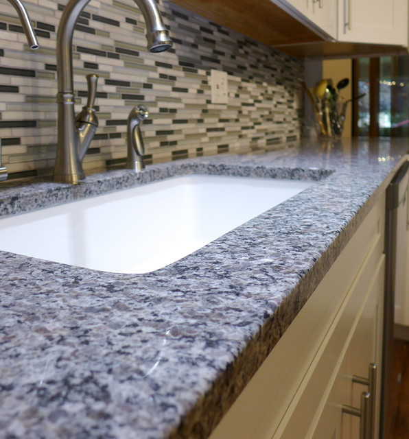 Caledonia Granite Kitchen Contemporary with Backsplash Black Tile Counter