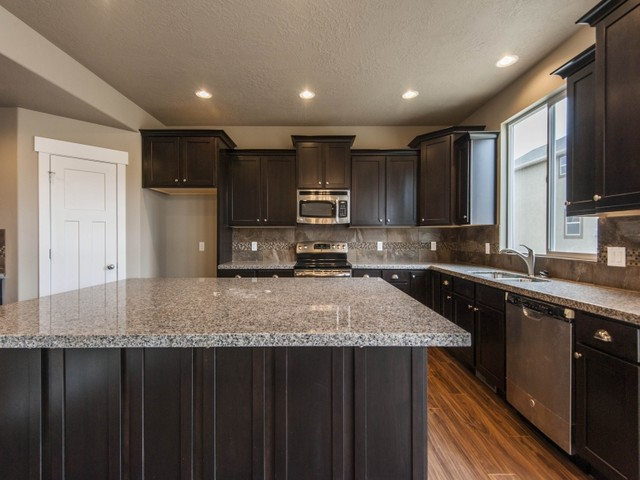 Caledonia Granite Kitchen Traditional with 4 Car Garage Craftsman