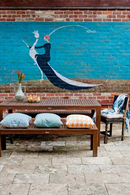 Celebrity Homes Omaha Patio Eclectic with Artwork Exposed Brick Mural