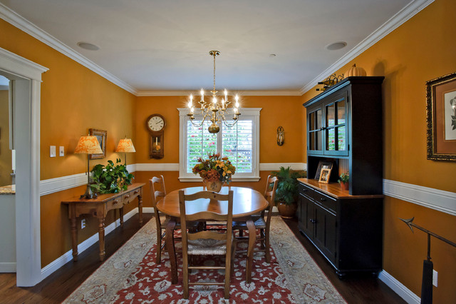 chair rail height Dining Room Traditional with area rug baseboards chair