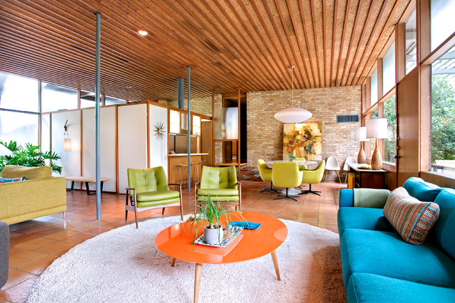 circular rugs Family Room Midcentury with beige rug brick wall