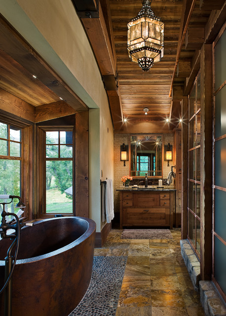 copper bathtub Bathroom Rustic with beige wall brown stone