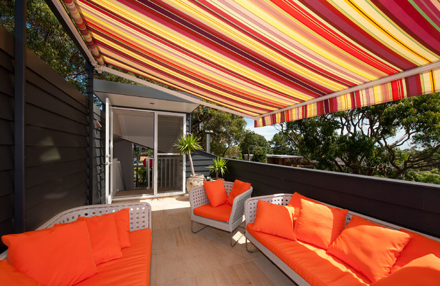 deck awnings Deck Contemporary with bright colours covered deck