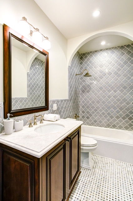 Delta Cassidy Bathroom Mediterranean with Arabesque Tile Framed Mirror