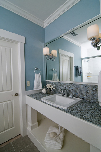 delta dryden Bathroom Beach with blue walls bullet tiles