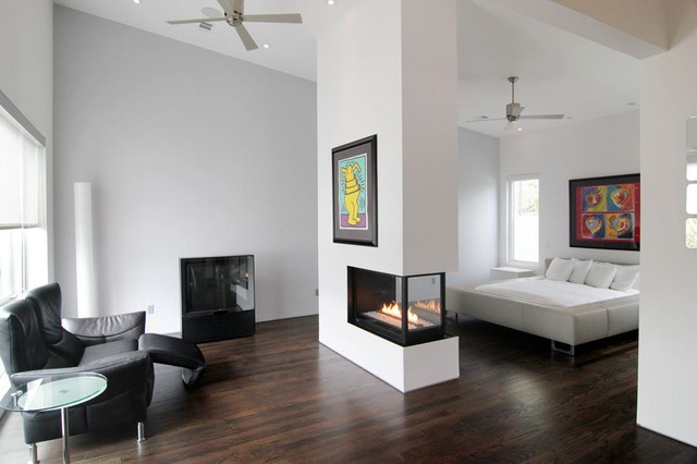 Double Sided Fireplace Bedroom Contemporary with Abstract Artwork Bedroom Sitting