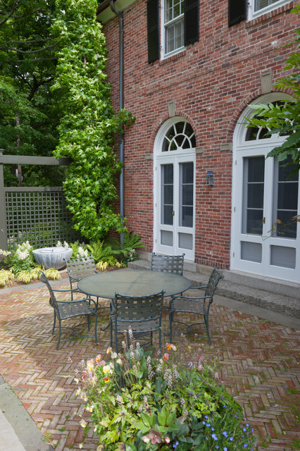 Faux Brick Panels Patio Traditional with Arched Door Arched Windows