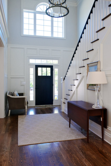 front door with sidelights Entry Traditional with beige rug chandelier clear