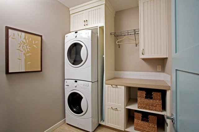 Full Size Stackable Washer and Dryer Laundry Room Traditional with Artwork Beadboard Cabinets Dryer