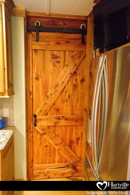 Hartville Hardware Spaces Rustic with Barn Door Barn Door1