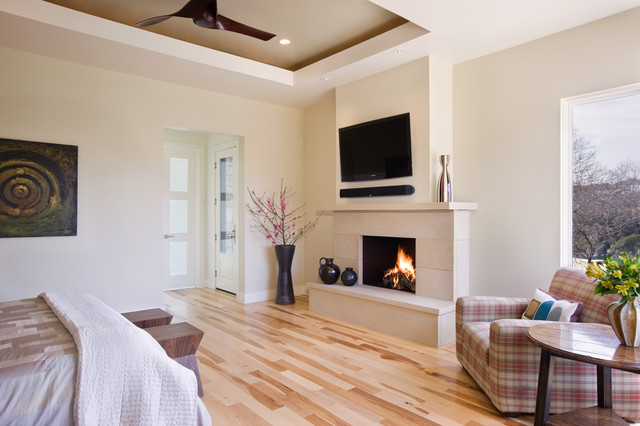 Hickory Hardwood Flooring Bedroom Contemporary with Artwork Ceiling Fan Fireplace