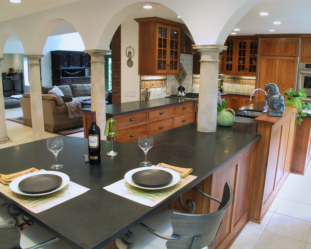 honed granite Kitchen Mediterranean with arch black counters breakfast