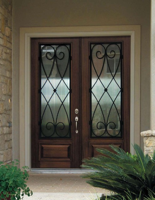 Legacy Homes Omaha Entry Mediterranean with Door Wrought Iron Doors