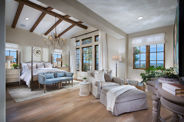oversized chair and ottoman Bedroom Mediterranean with chandelier exposed wood beams