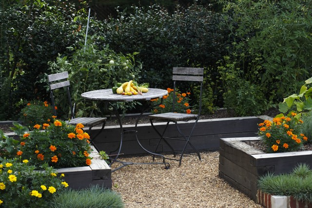 Pea Gravel Landscape Traditional with Cafe Chairs Edible Garden