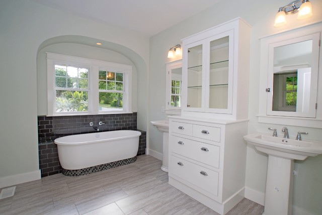 Pedestal Sink Cabinet Bathroom Traditional with Arch Over Tub Center